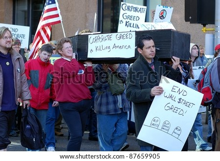MINNEAPOLIS - OCTOBER 29:  Unidentified participants in the Occupy Minnesota protest on October 29, 2011 in Minneapolis.  Occupy protests are a worldwide movement against corporate greed. - stock photo