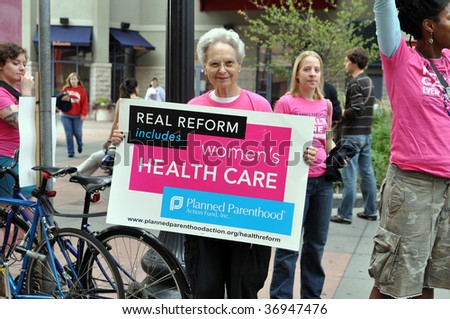 MINNEAPOLIS - SEPTEMBER 12: An advocate for Health Care Reform protests outside of Barack Obama's Health Care Reform speech at the Target Center on September 12, 2009 in Minneapolis. - stock photo