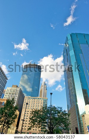 Minneapolis  skyline against a blue sky with white puffy clouds. - stock photo