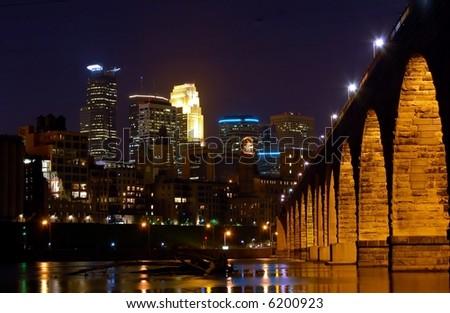 Minneapolis Skyline and Stone Arch - stock photo