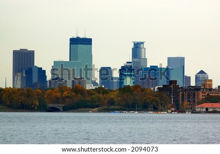 Minneapolis skyline over Lake Calhoun with autumn foliage. More with keyword group18a