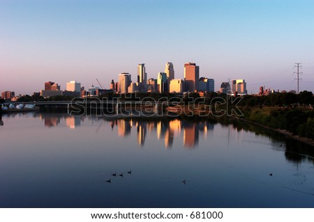 Minneapolis skyline reflecting in the Mississippi River. - stock photo