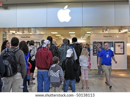 MINNETONKA MN. - APRIL 3:  Customers waiting in line to purchase Apple Ipads on launch day, April 3, 2010, at the Apple Store in Minnetonka, MN. - stock photo