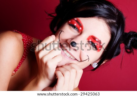 Minnie mouse make-up on a smiling girl - stock photo