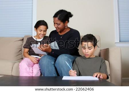 Minority woman and her children - stock photo