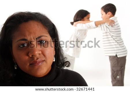 Minority woman with her children fighting in the background - stock photo
