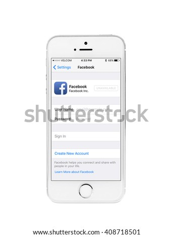 Minsk, Belarus - April 16, 2016: Apple iPhone 5S with page Facebook. The founders of the company: Steve Jobs, Ronald Wayne, Steve Wozniak. Apple Inc. Located in USA. - stock photo