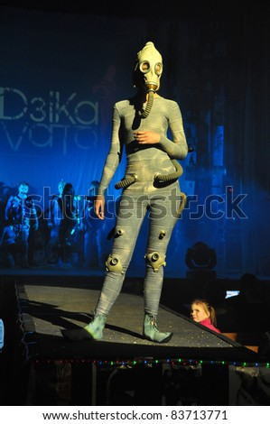 "MINSK, BELARUS. APRIL 23: Festival of fashion ""DZIKA VITA"". An unidentified young beautiful female showing leather image at the festival of fashion in Minsk, Belarus.  April23, 2009."