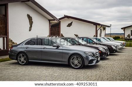 MINSK, BELARUS - APRIL 21, 2016: Range of 6 generation of modern Mercedes-Benz E-class are on display during a presentation event in Minsk, Belarus. - stock photo