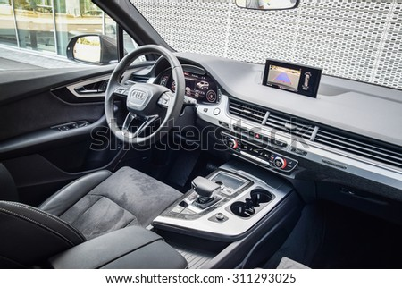 MINSK, BELARUS - AUGUST 28, 2015: 2015 model year all-new Audi Q7 3.0 TFSI interior on display at test drive event for automotive journalists. - stock photo