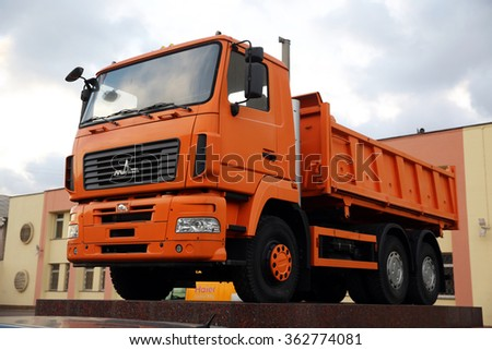 MINSK, BELARUS - DECEMBER 07, 2015: MAZ 6501 DUMP TRUCK AT THE ENTRANCE OF THE MINSK AUTOMOBILE WORKS (MAZ). IT'S PRODUCED FROM 2008 TILL PRESENT