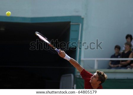 MINSK, BELARUS - JULE 11: Max Mirnyi plays against Netherlands player in the Davis Cup on Jule 11, 2010 in Minsk, Belarus - stock photo