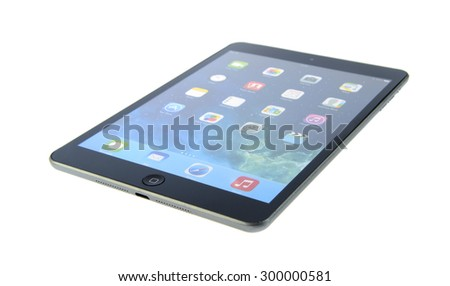 Minsk, Belarus - July 25, 2015: Apple iPad mini. A smaller version of the iPad. The operating system iOS. The founders: Steve Jobs, Steve Wozniak, Ronald Wayne. Apple Inc. located in United States. - stock photo