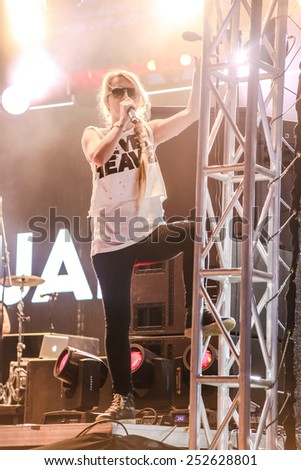MINSK, BELARUS - JULY 3: Sandra Nasic and Guano Apes rock band perform during Most festival on Borovaya airfield in Minsk, July 3, 2014. - stock photo