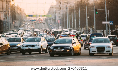 MINSK, BELARUS - MARCH 10, 2015: Busy Movement On Independence Avenue During Evening Time. Traffic Slow Moving On Street. - stock photo