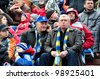 MINSK, BELARUS - MARCH 25:FC Bate Borisov VS FC MINSK, unidentified soccer fans (FC BATE)  watching match on March 25, 2012 in Minsk, Belarus - stock photo