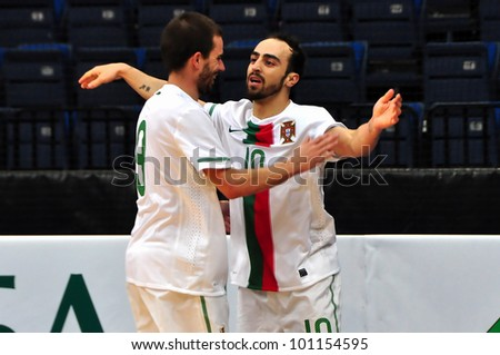 MINSK, BELARUS - MARCH 26: qualification World Cup 2012, Belarus � Portugal: Gonzalo(left) congratulates with the goal Ricardinho (Portugal) on March 26, 2012 in Minsk, Belarus - stock photo