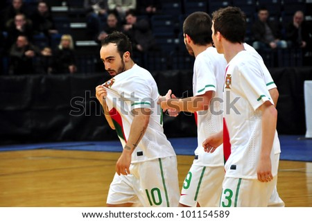 MINSK, BELARUS - MARCH 26: qualification World Cup 2012, Belarus � Portugal: Leader of the Portuguese national team- Ricardinho(left) after goal on March 26, 2012 in Minsk, Belarus - stock photo
