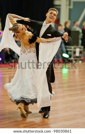 MINSK-BELARUS, MARCH 4: Unidentified Dance Couple performs Adults Standard Program on The Republic of Belarus WDSF Championship, 2 Stage, on March 4, 2012 in Minsk, The Republic of Belarus