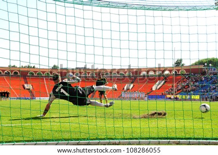 MINSK, BELARUS MAY 20: Artur Lesko (goalkeeper FC Minsk) missing the penalty during final cup match between FC NAFTAN and FC MINSK on May 20, 2012 in Minsk, Belarus - stock photo