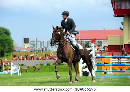 MINSK, BELARUS - MAY 27: Benas GUTKAUSKAS (LTU) finishes with 1 mistake in (CSIO2*-W 160cm) during KAP JUMPING HORSE SHOW 2012 on May 27, 2012 in Minsk, Belarus. - stock photo