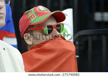 MINSK, BELARUS - MAY 20: Fan of Belarus during 2014 IIHF World Ice Hockey Championship match at Minsk Arena on May 20, 2014 in Minsk, Belarus. - stock photo