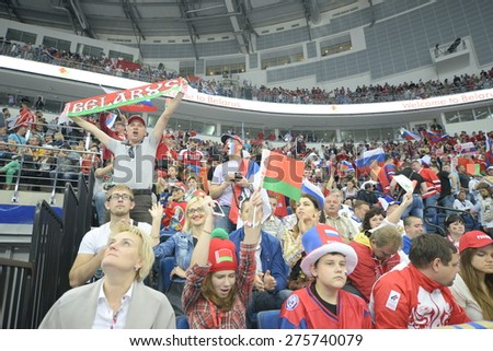 MINSK, BELARUS - MAY 20: Fans of Russia and Belarus during 2014 IIHF World Ice Hockey Championship match at Minsk Arena on May 20, 2014 in Minsk, Belarus. - stock photo