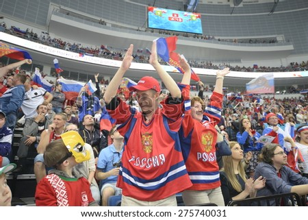 MINSK, BELARUS - MAY 20: Fans of Russia during 2014 IIHF World Ice Hockey Championship match at Minsk Arena on May 20, 2014 in Minsk, Belarus. - stock photo