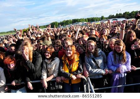 MINSK, BELARUS - MAY 23: Festival of Rock Music BELAMUSIC. Fans enjoying headliners  NEURO DUBEL band in open-air annual music festival in Minsk, Belarus. May 23, 2009. - stock photo