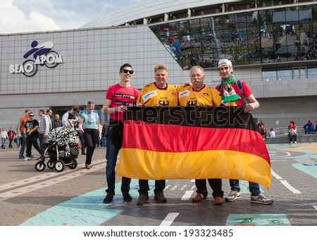 MINSK, BELARUS - May 17, 2014: ICE HOCKEY WORLD CHAMPIONSHIP, MINSK-ARENA, The hockey fans from Germany and Belarus in the uniform of theirs national teams and German flag - stock photo
