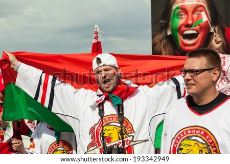 MINSK, BELARUS - May 17, 2014: ICE HOCKEY WORLD CHAMPIONSHIP, MINSK-ARENA, The hockey fans from Belarus with national flag in the uniform of theirs national team - stock photo