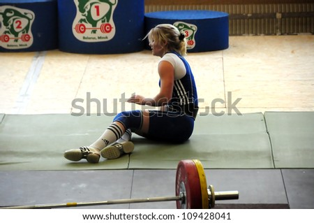 MINSK, BELARUS MAY 31: Unidentified athlete feels dizziness after attemt during Belarus Open Championship in weightlifting on May 31, 2012 in Minsk, Belarus