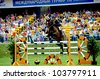 MINSK, BELARUS - MAY 27: Unidentified sportsmen from Belarus overcomes barrier in (CSIO2*-W 160 ??) during KAP JUMPING HORSE SHOW 2012 on May 27, 2012 in Minsk, Belarus. - stock photo