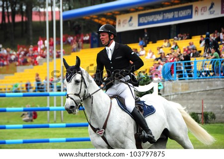MINSK, BELARUS - MAY 27: Unidentified sportsmen starts the compeition in (CSIO2*-W 160 ??) during KAP JUMPING HORSE SHOW 2012 on May 27, 2012 in Minsk, Belarus.