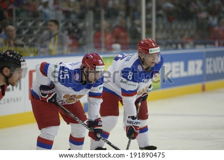 MINSK, BELARUS - MAY 9: Zaripov Danis (L) and Ovechkin Alexander looks on during the IIHF World Championship match between Russia and Switzerland at Minsk Arena on May 9, 2014 in Minsk, Belarus.
