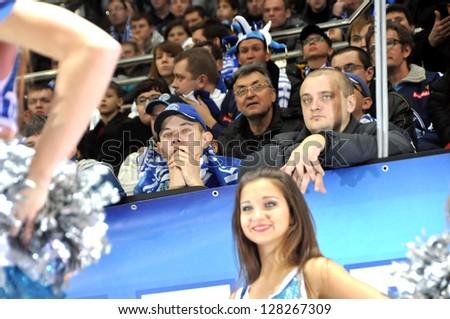 MINSK, BELARUS - NOVEMBER 28: Unidentified fans watching KHL regular match Dynamo Minsk VS Avtomobilist  Yekaterinburg on November 28, 2012 in Minsk, Belarus. - stock photo
