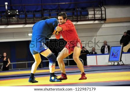 MINSK, BELARUS - NOVEMBER 10: Unidentified wrestlers compete during SAMBO (Wrestling) WORLDCh-2012 on November 10, 2012 in Minsk, Belarus. - stock photo