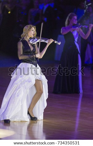 Minsk, Belarus-October 7, 2017: Palladium Electric Band Female Violinist Elena Polyakova Performing on WDSF International Capital Cup Minsk,October 7,2017, Minsk,Belarus.