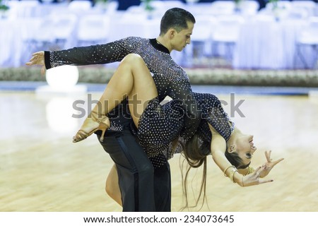 Minsk-Belarus, October 4,2014: Unidentified Professional dance couple performs Adult Latin-American program on World Open Minsk-2014 WDSF Championship in October 4, 2014 in Minsk, Republic Of Belarus - stock photo