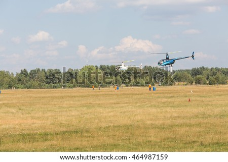 "Minsk, Belarus on 31 July 2015. Air sports festival ""ProNebo 2016"" . helicopter races. Robinson R44"