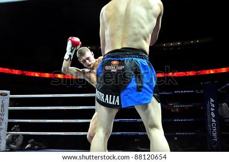 MINSK, BELARUS-SEPTEMBER 12:Andrej Kulebin(kicking) Belarus VS Taylor Harvey(right) Australia fighting at BIG8 MUAY-THAY CHAMP in Minsk, Belarus on September 12, 2010 - stock photo