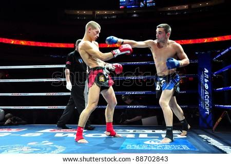 MINSK, BELARUS-SEPTEMBER 12:Andrej Kulebin(left) of Belarus VS Taylor Harvey (right) of Australia fight at the BIG8 MUAY-THAY CHAMP in Minsk, Belarus on September 12, 2010 - stock photo