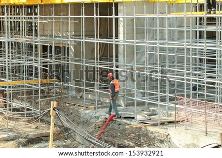 MINSK, BELARUS - SEPTEMBER 12, 2013: construction workers doing work at the construction renaissance