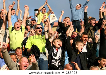 MINSK, BELARUS - SEPTEMBER 13: Match DYNAMO Minsk VS TORPEDO Jodino, unidentified soccer fans celebrating goal on September 13, 2009 in Minsk,  Belarus - stock photo