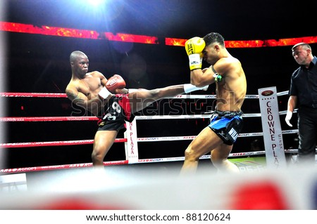 MINSK, BELARUS-SEPTEMBER 12: Mthobisi Buthelezi (Africa) on left VS Erkan Varol (Turkey) on right fight at the BIG8 MUAY-THAY CHAMP in Minsk, Belarus on September 12, 2010 - stock photo