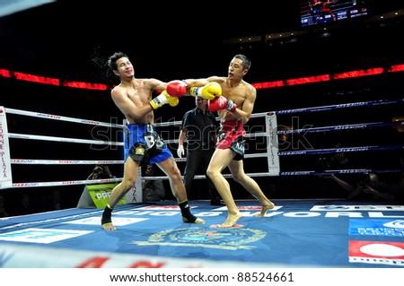 MINSK, BELARUS-SEPTEMBER 12:. Sudsakorn Klinmi (L) VS Michael Manankyuil (North America) compete in the semifnal Fight at BIG8 MUAY-THAY CHAMP in Minsk, Belarus on September 12, 2010 - stock photo