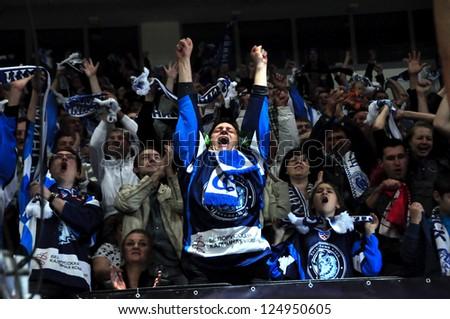 MINSK, BELARUS - SEPTEMBER 15:Unidentified Dynamo fans celebrate a goal during KHL regular match Dynamo Minsk VS CSKA Moskow on September 15, 2012 in Minsk, Belarus. - stock photo