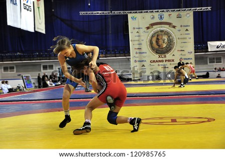 MINSK, BELARUS - SEPTEMBER 16: Unidentified female (blue) stops the moving during Grand Prix for the prizes A.Medved in freestyle wrestling on September 16, 2012 in Minsk, Belarus. - stock photo