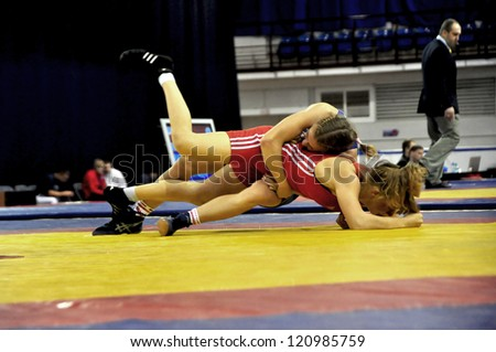 MINSK, BELARUS - SEPTEMBER 16: Unidentified females fighting in the pit during Grand Prix for the prizes A.Medved in freestyle wrestling on September 16, 2012 in Minsk, Belarus.