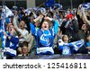 MINSK, BELARUS - SEPTEMBER 13: Unidentified spectators celebrate a goal during KHL regular match Dynamo Minsk VS Slovan Brotislava on September 13, 2012 in Minsk, Belarus. - stock photo